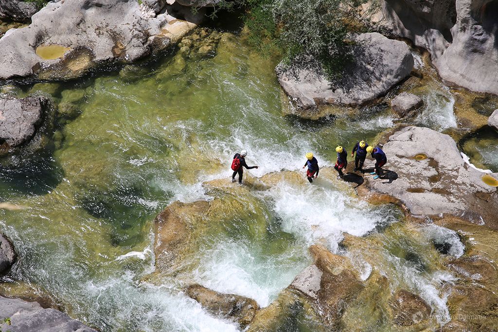 Rapids of the Cetina river. Canyoning tour.