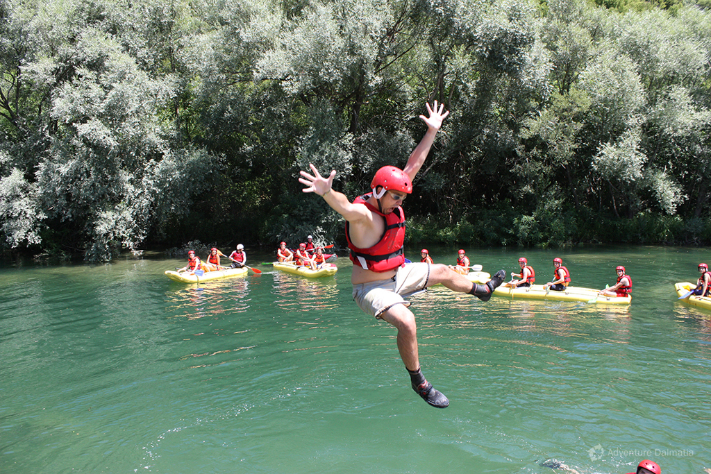 Jumping into the river during the rafting tour.