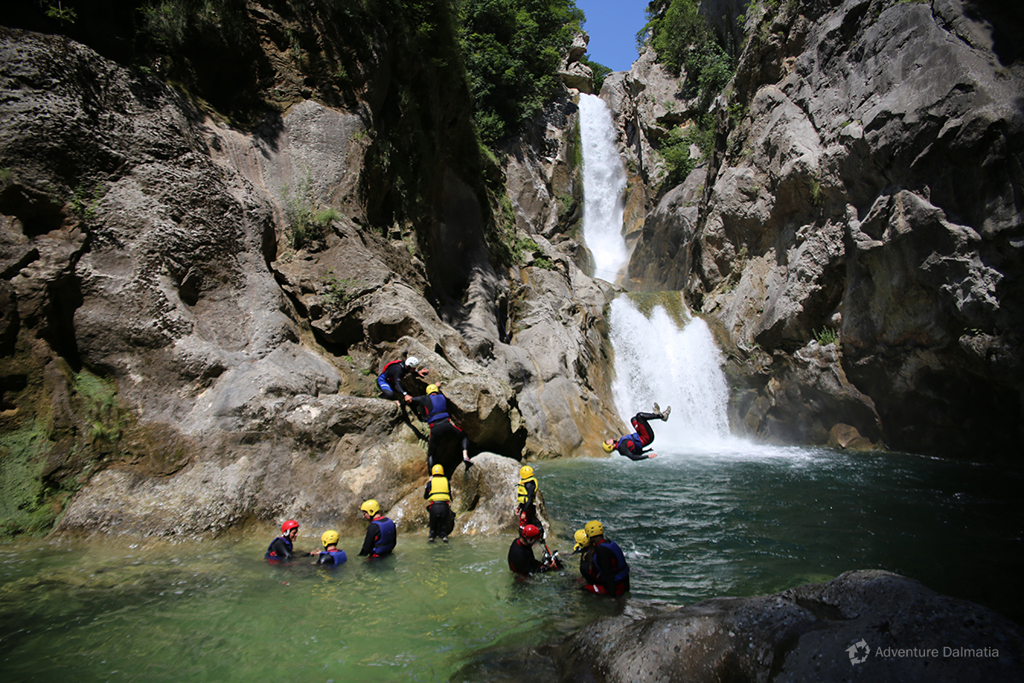 Velika Gubavica (55m) waterfalls on Cetina river. Canyoning tour.