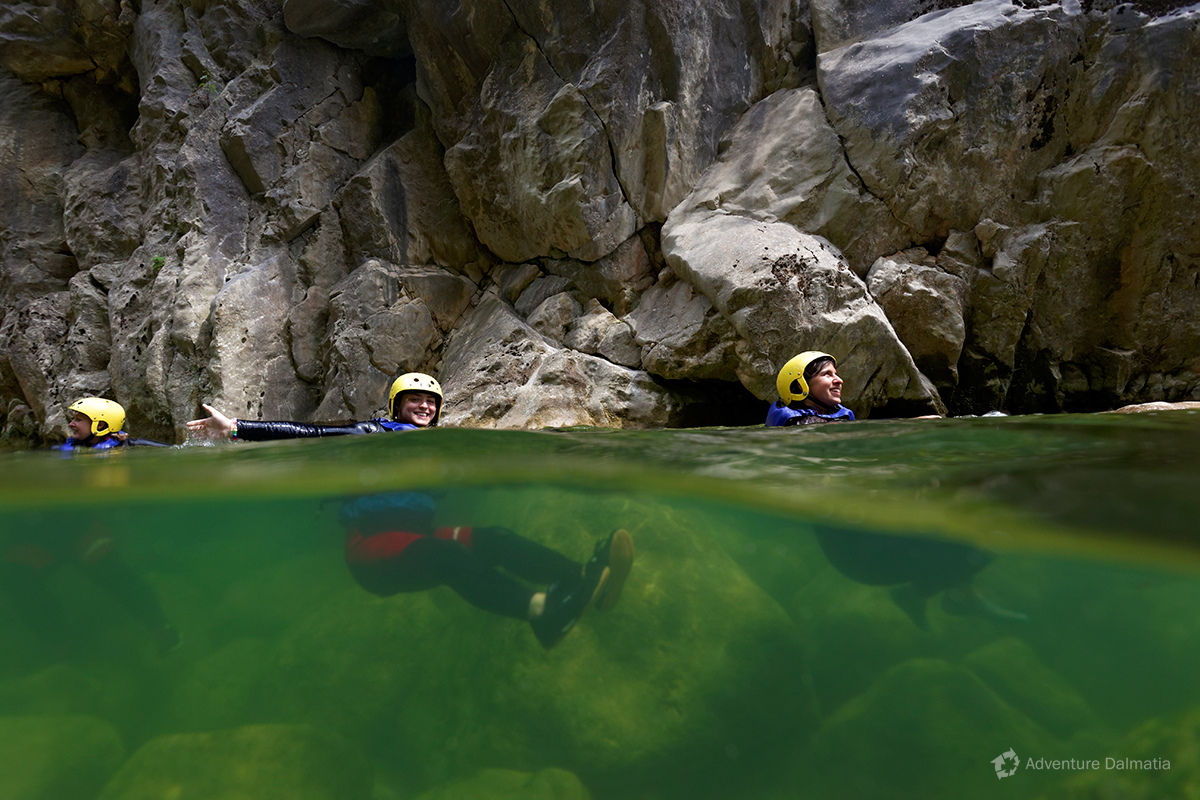 Floating on crystal green waters in Cetina river gorge - Cetina canyoning tour.