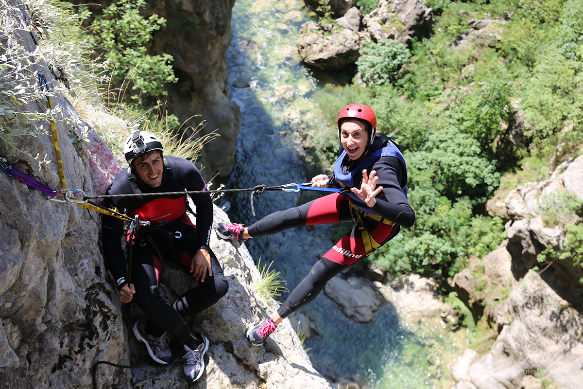 Adrenaline rush at the edge of the 55m cliff in the Cetina River canyon is a part of Extreme Canyoni