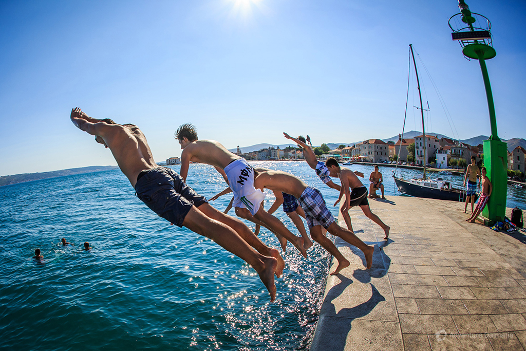 Jumping from the dock in Kaštela town near Split