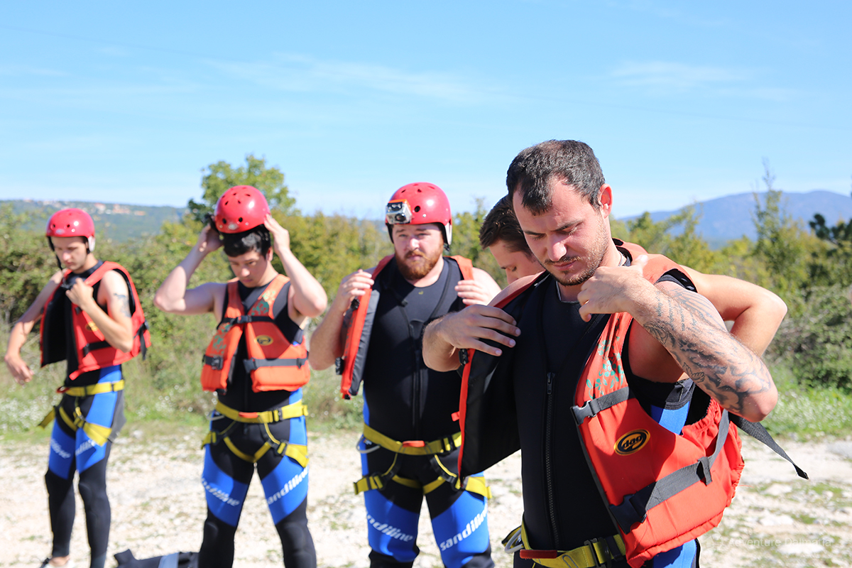 On a starting point for the canyoning tour in Zadvarje village, adjusting life jackets