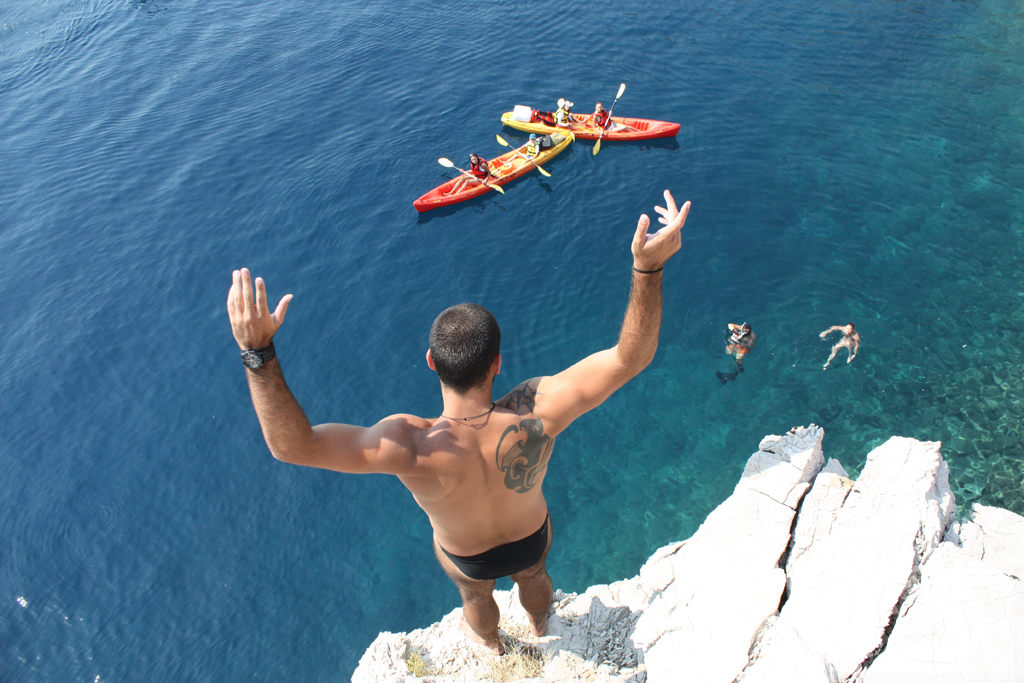 Cliff jumping on a sea kayaking tour in Brela is optional