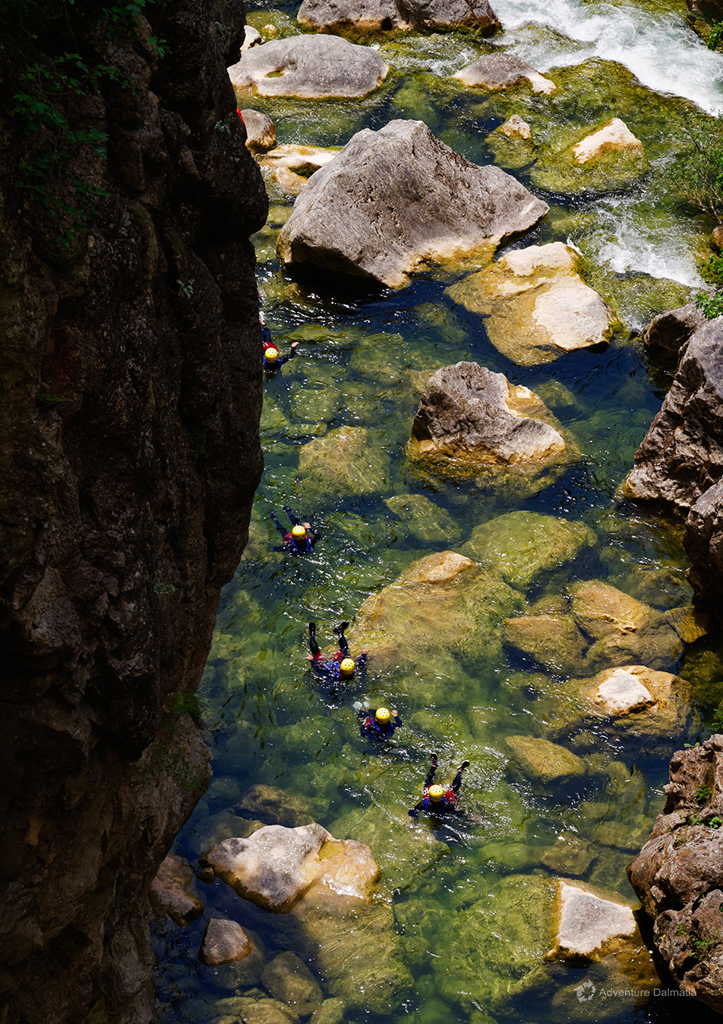Floating through the crystal clean waters of Cetina river near Omiš