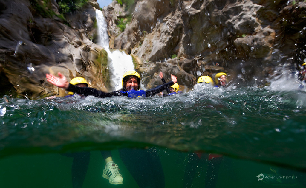 Happiness after abseiling, under the waterfall Velika Gubavica