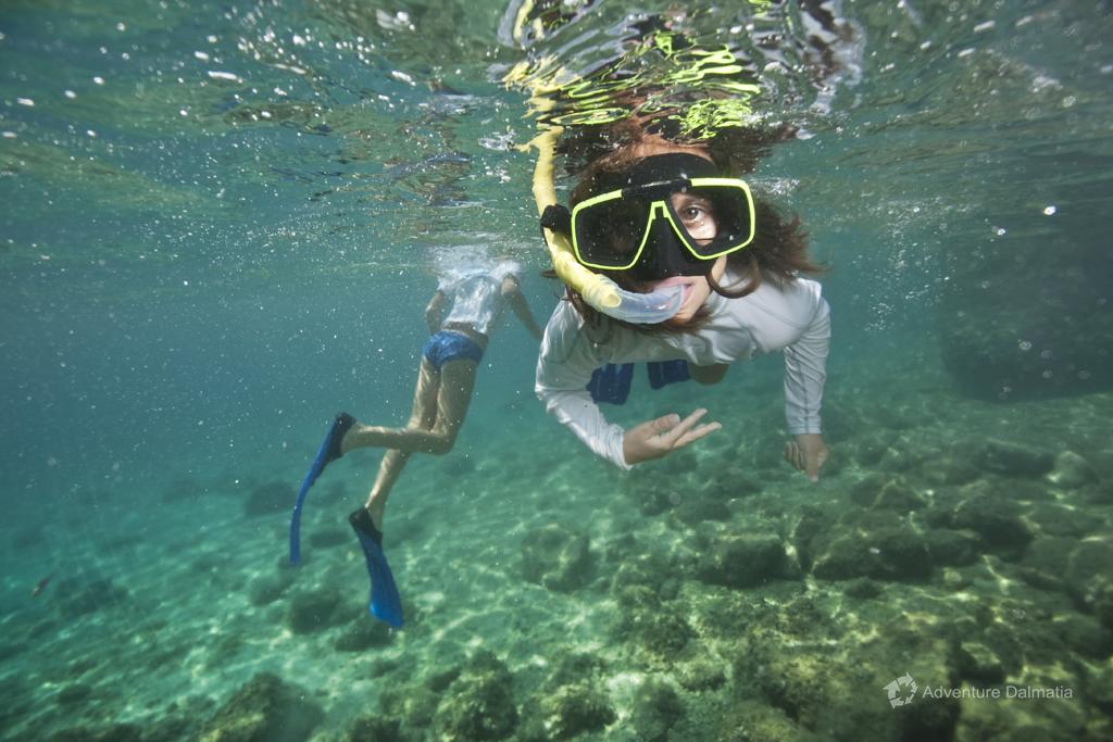 Having fun on a snorkeling break on a sea kayaking tour in Brela