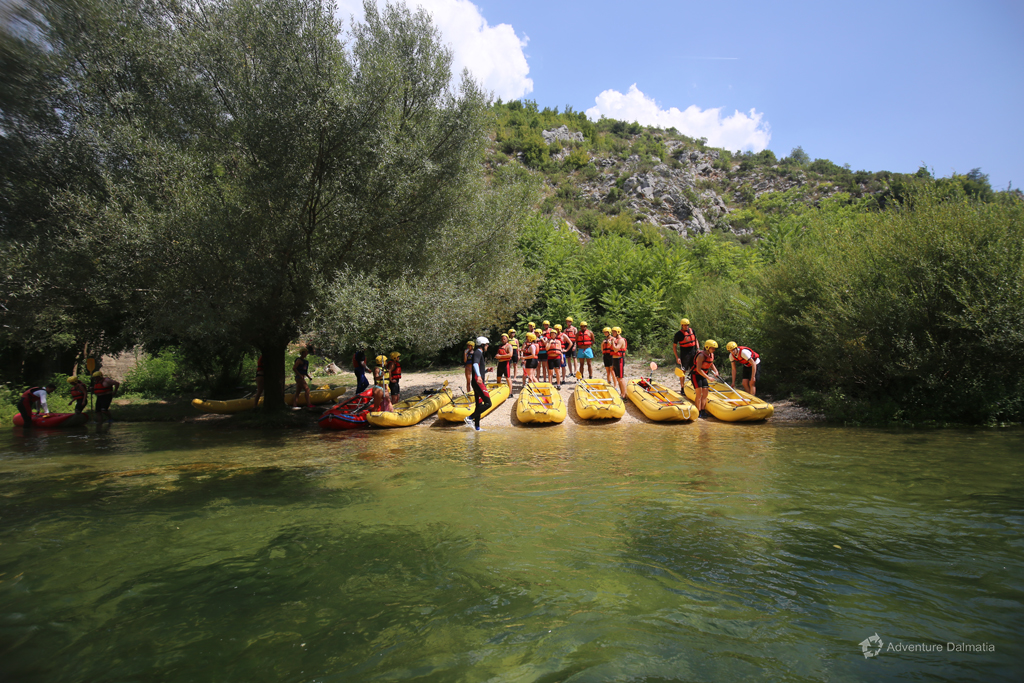 Rafting tour starts from hidden river beach with a safety briefing