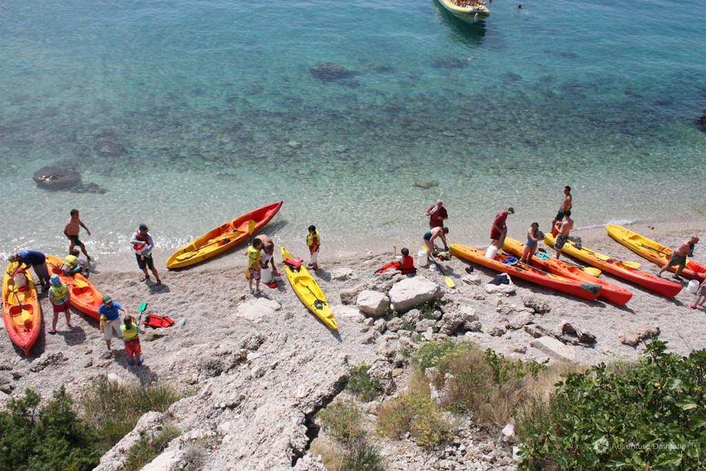 Kayaking break near Vrulja cove in Brela