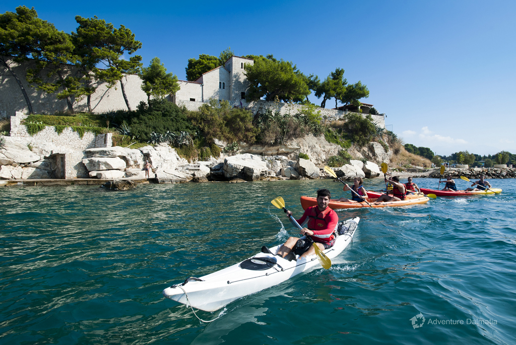 Paddling along beaches in Split