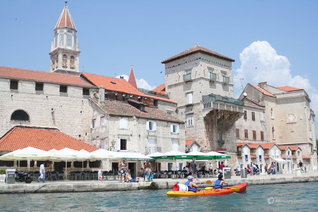 Paddling around Trogir town overlooking the promenade