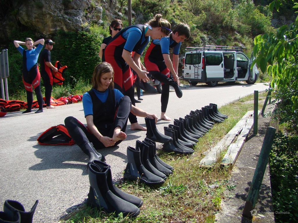 Preparing equipment for Cetina river rafting trip