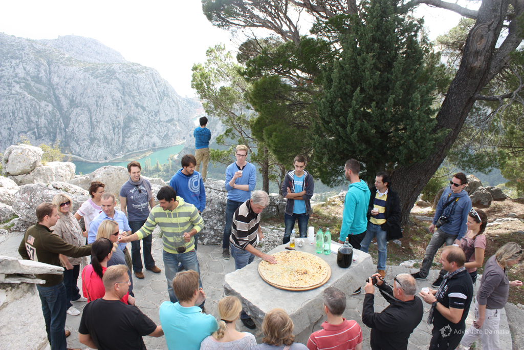 Tasting our traditional meal 'Soparnik' 400m above the canyon