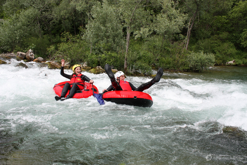 Tubing through the rapids, having a great time on Cetina river