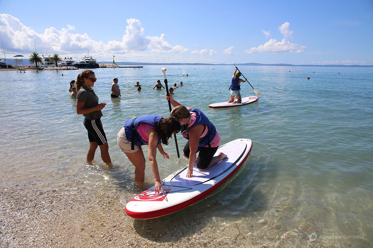 Team building games - Stand up Paddle race