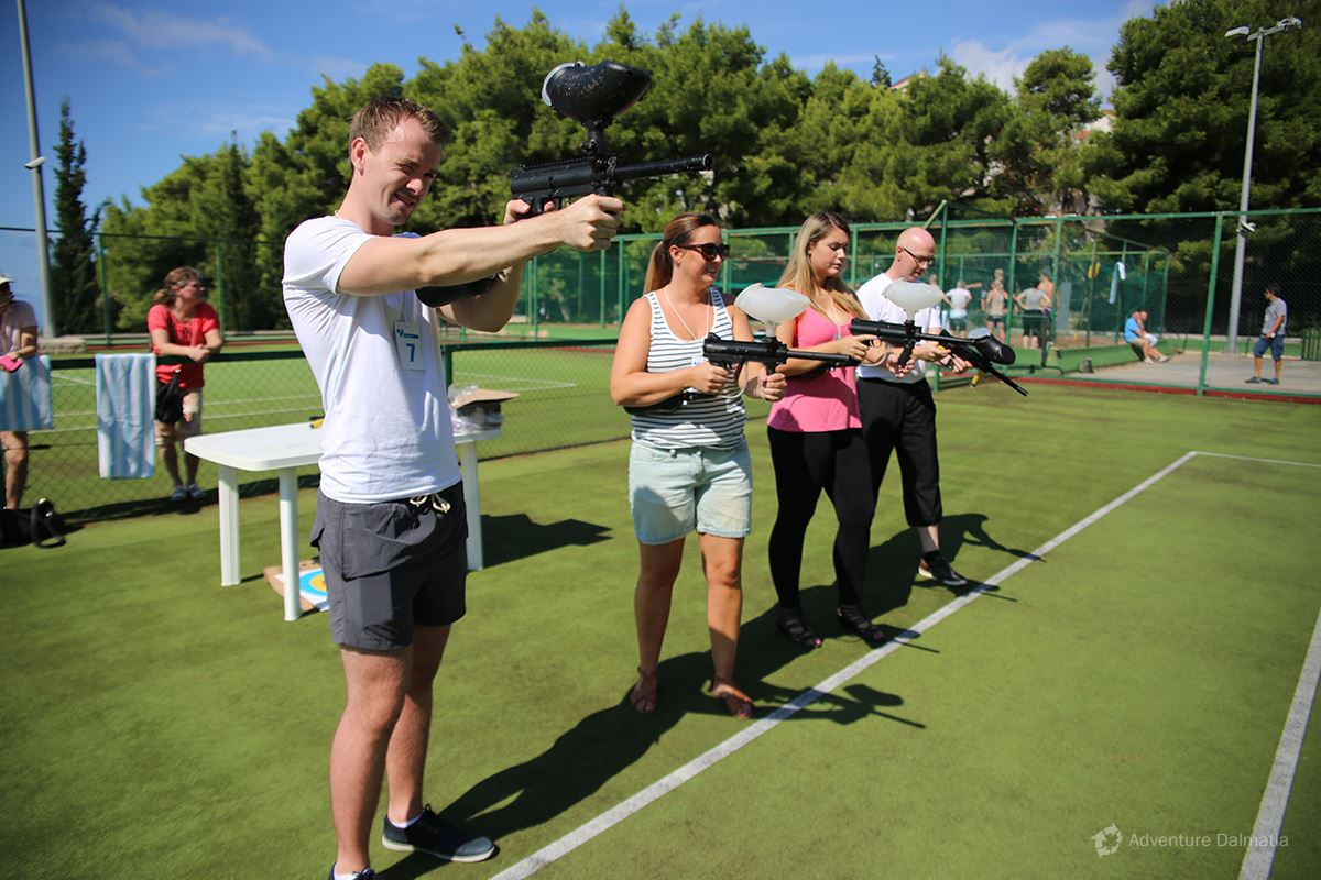 Team building games - Shooting a target with a paintball marker