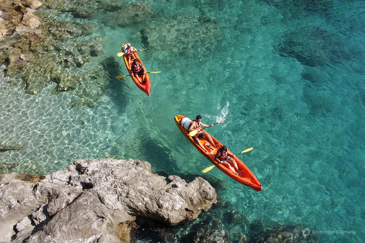 Exploring Lokrum coastline with kayaks