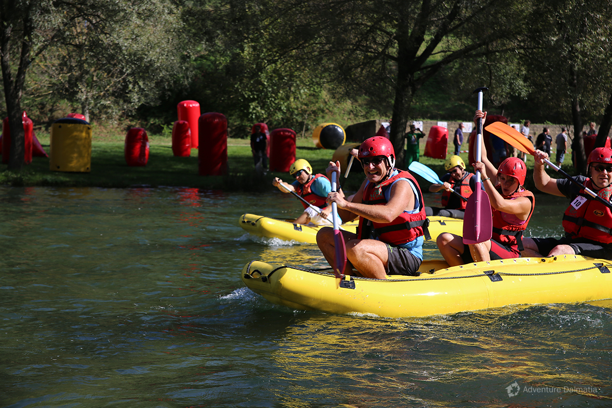 Rafting race, team building activities near the river