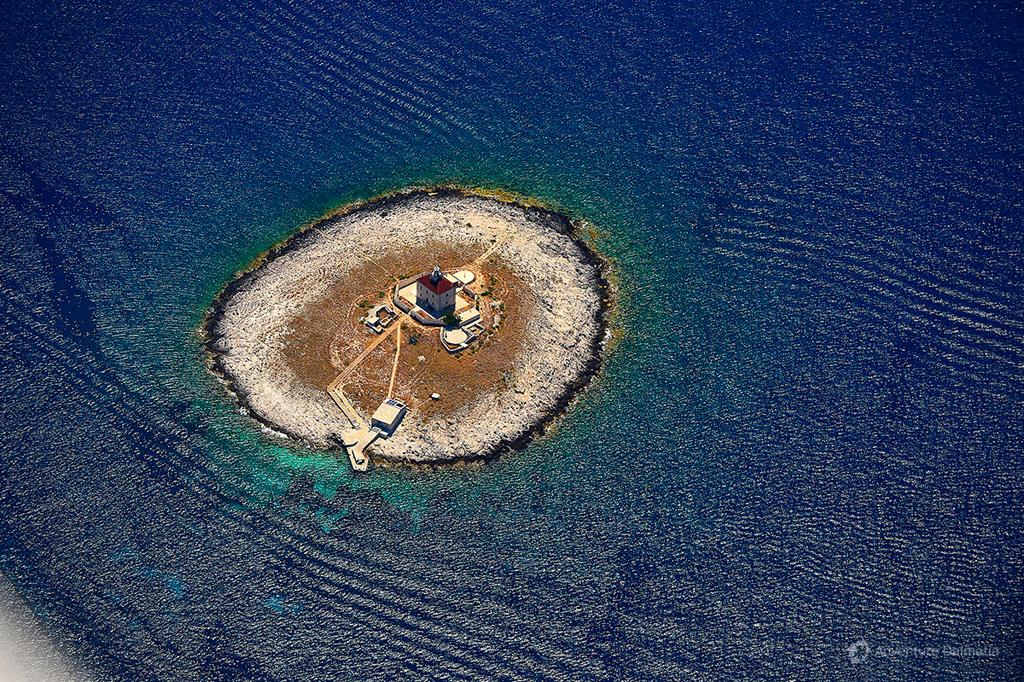 Lighthouse on the island of Pokonji Dol - Hvar island.