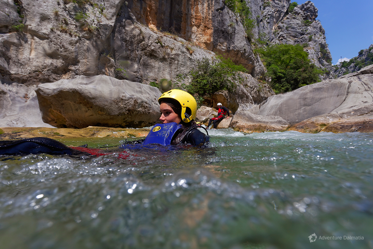 Sliding into the rapid - Cetina canyoning tour.
