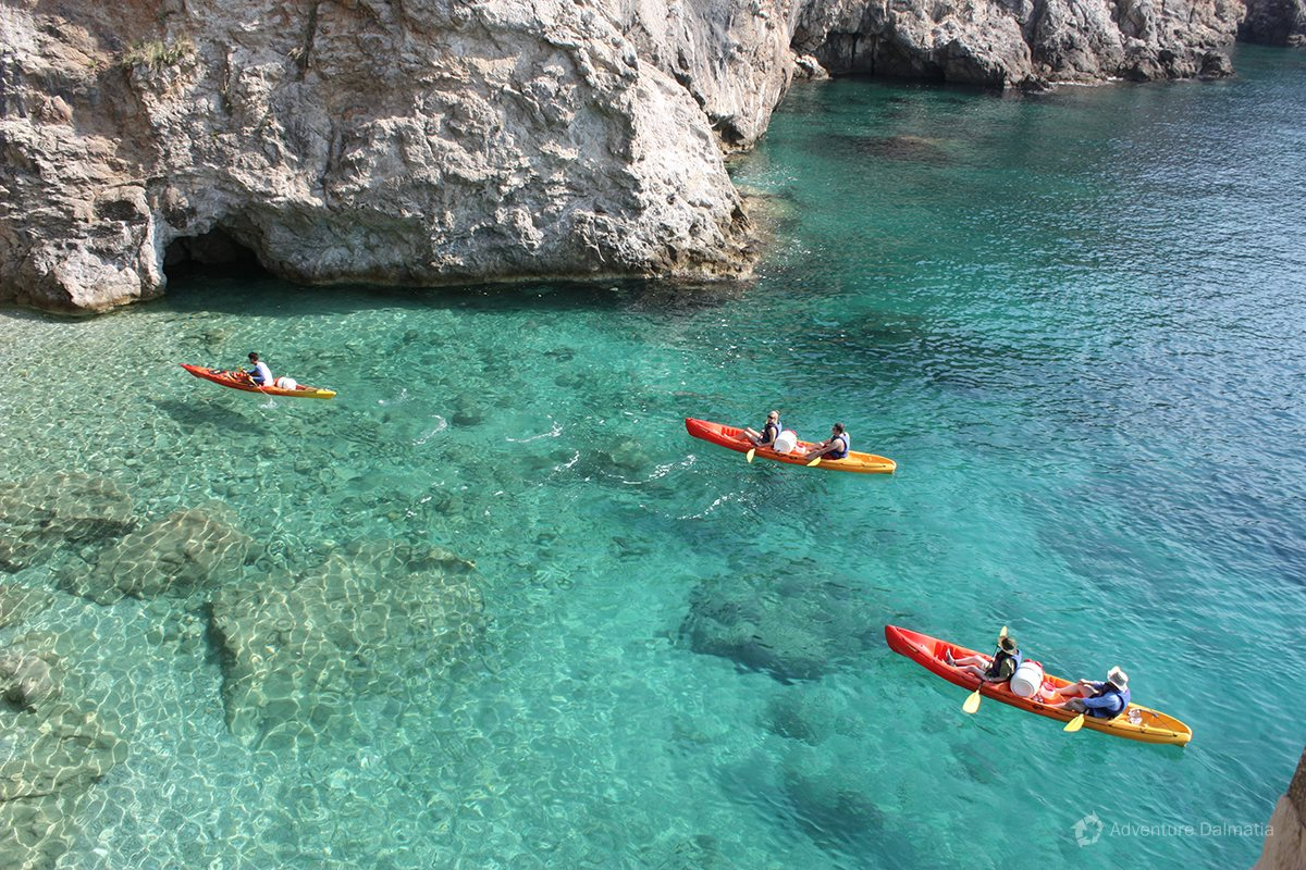 Exploring cliffs with kayaks on a sea kayaking tour with Adventure Dalmatia