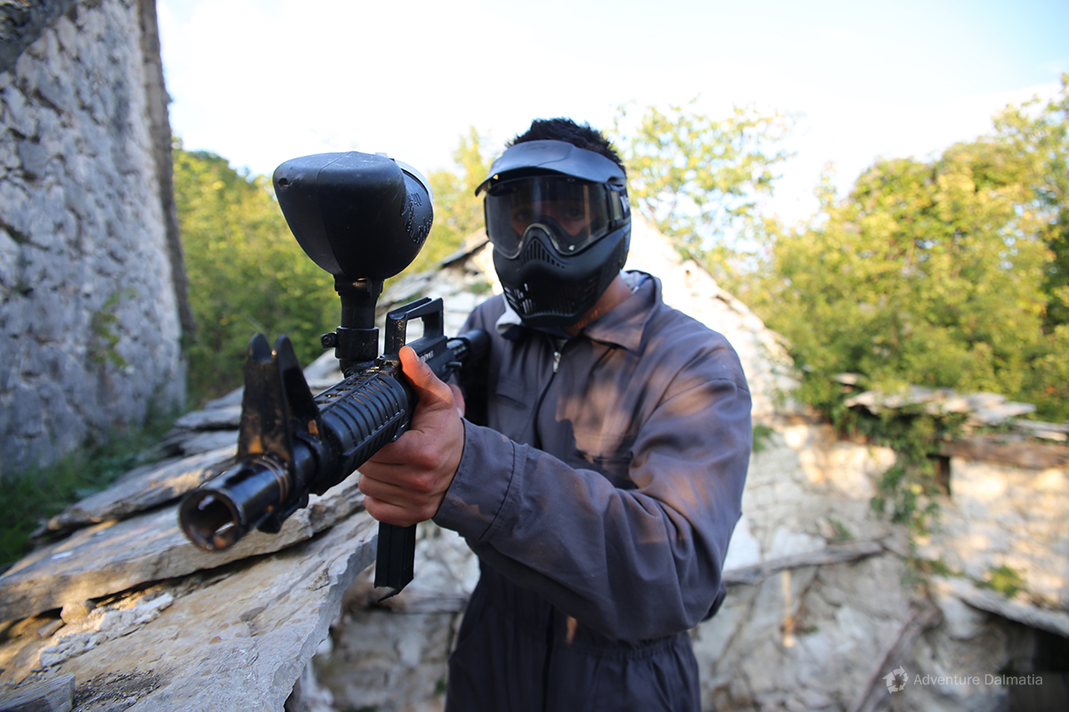 Taking careful steps at the house roof, Paintball