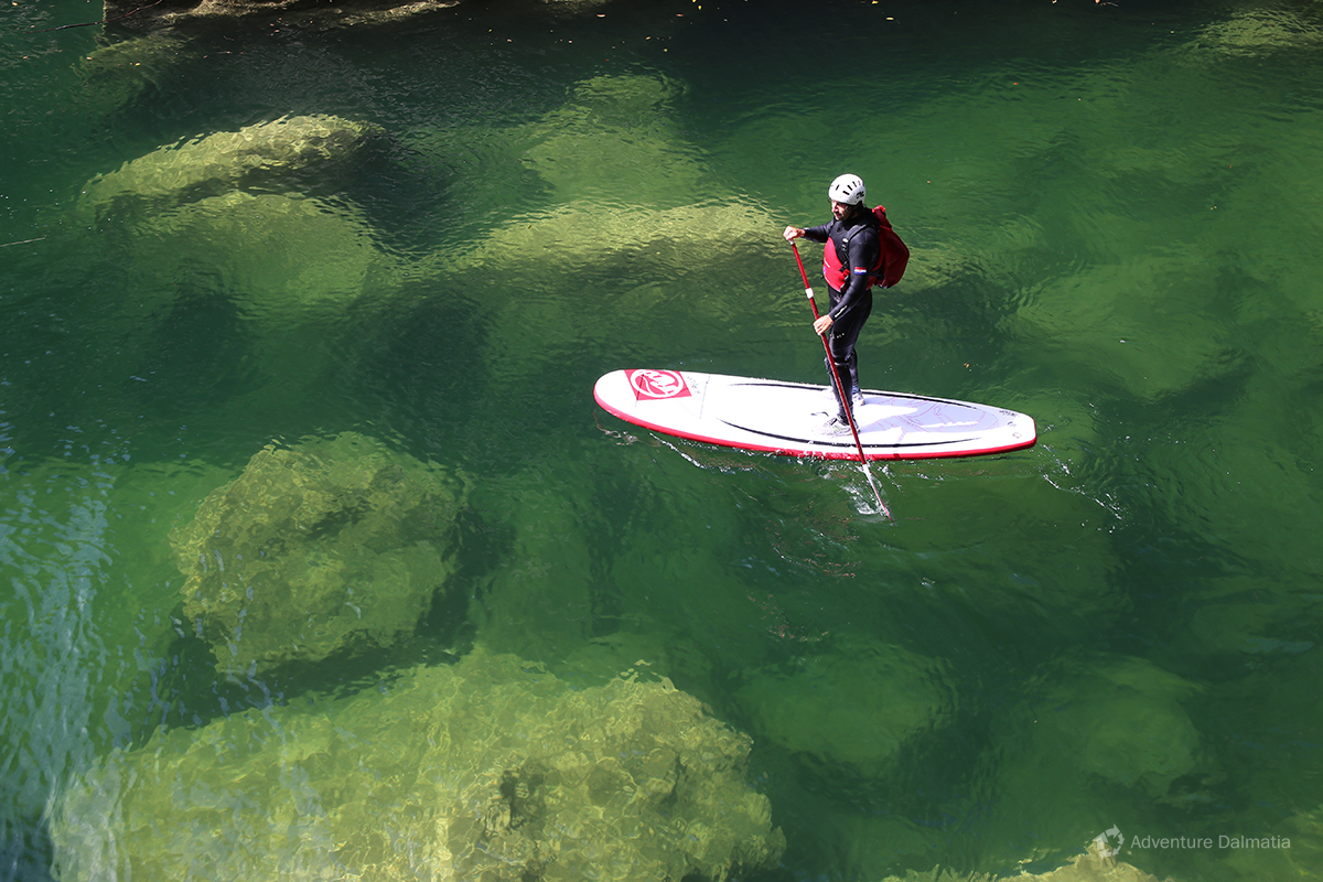 Stand up paddling on Cetina river.