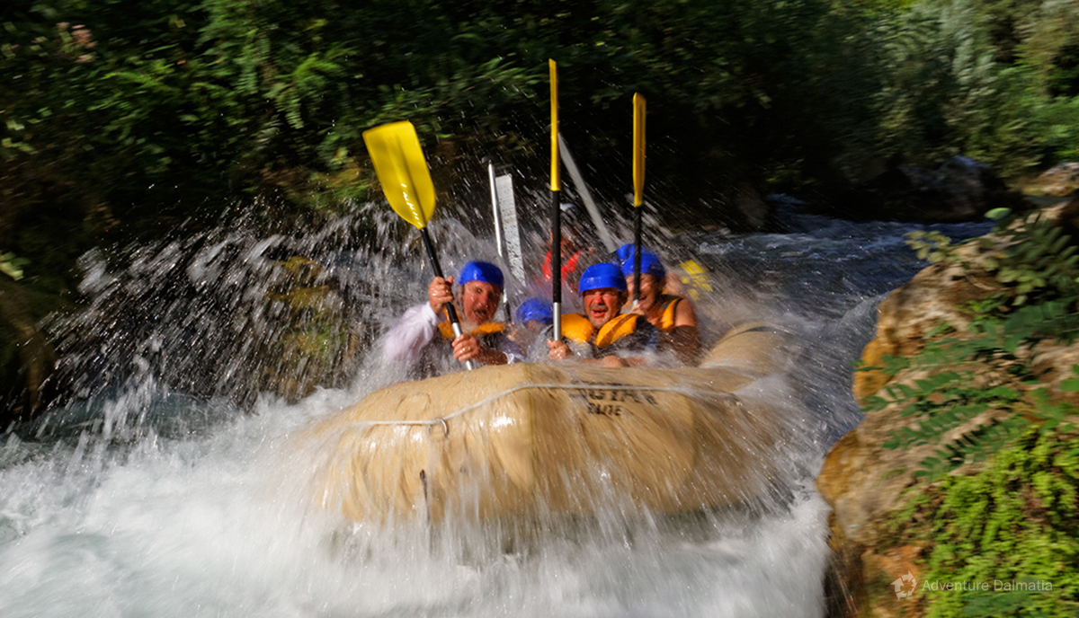Going down the rapid on a rafting activity.
