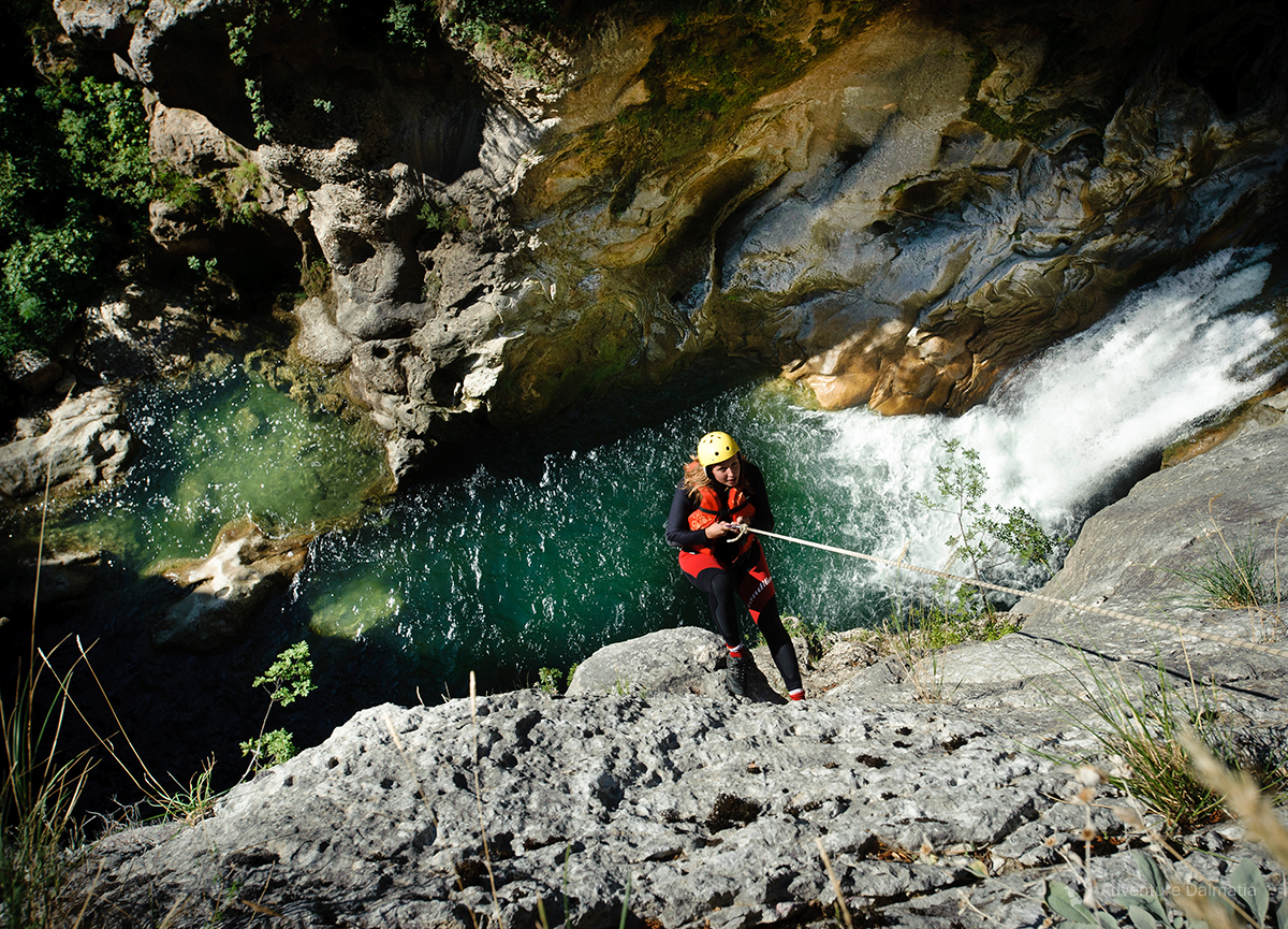 Abseiling near Velika Gubavica waterfall on Extreme canyoning activity