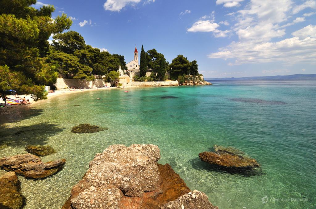 Beach and monastery near Bol town, Island of Brač.