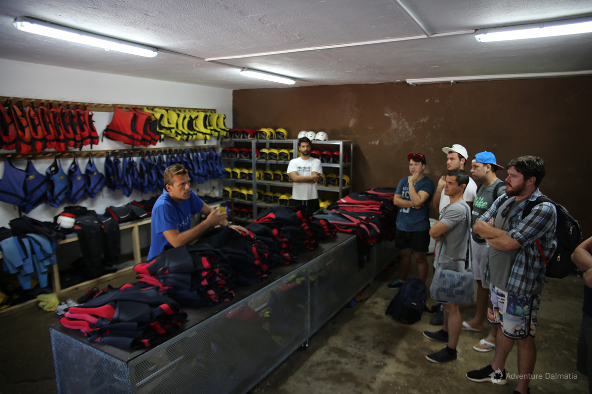 Guide explaining the equipment in our Canyoning center in Zadvarje village near the city of Split