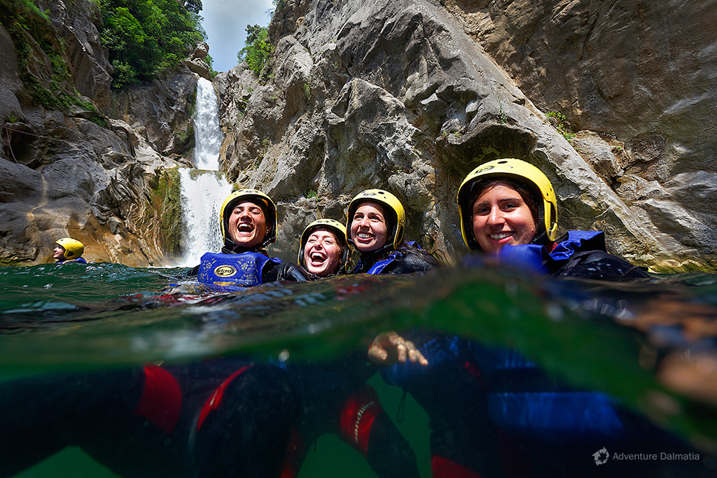 Under 55 meter waterfall on Cetina canyoning tour.