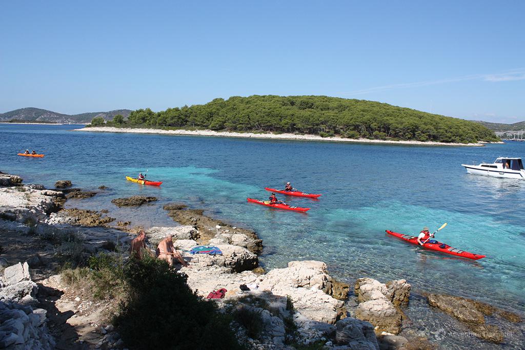 Sea kayaking around Pakleni islands archipelago.