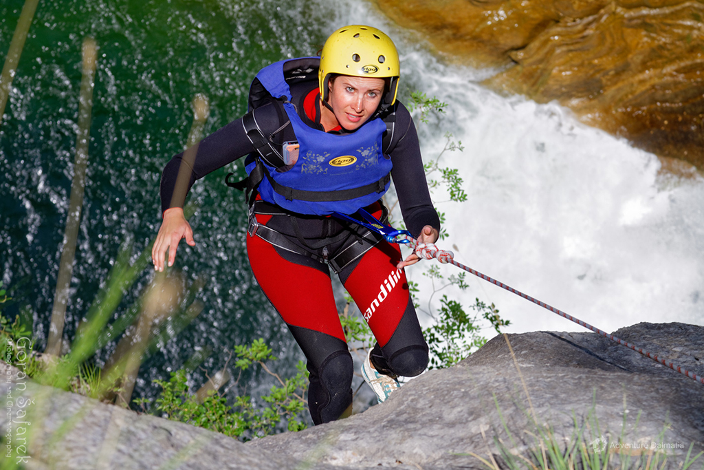 Abseiling from 55 meters near Velika Gubavica waterfall on Cetina river