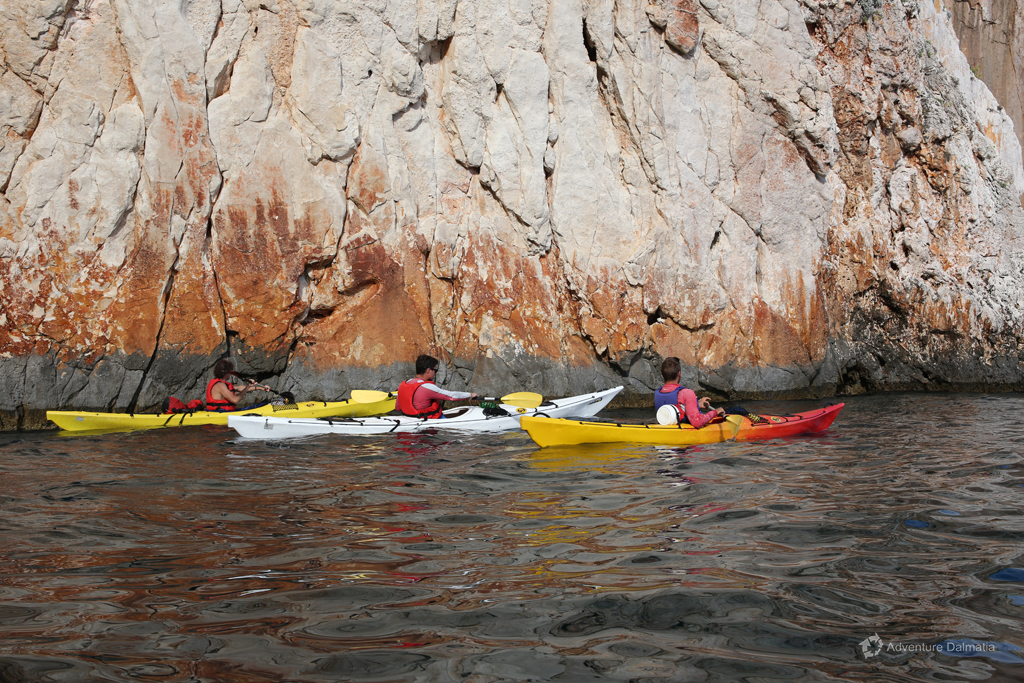 Admiring big cliffs on a kayaking tour with Adventure Dalmatia