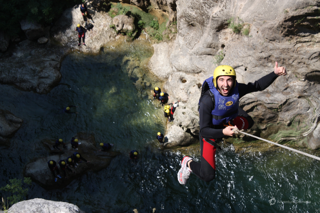 Enjoying the abseiling from 55m, Extreme Canyoning tour
