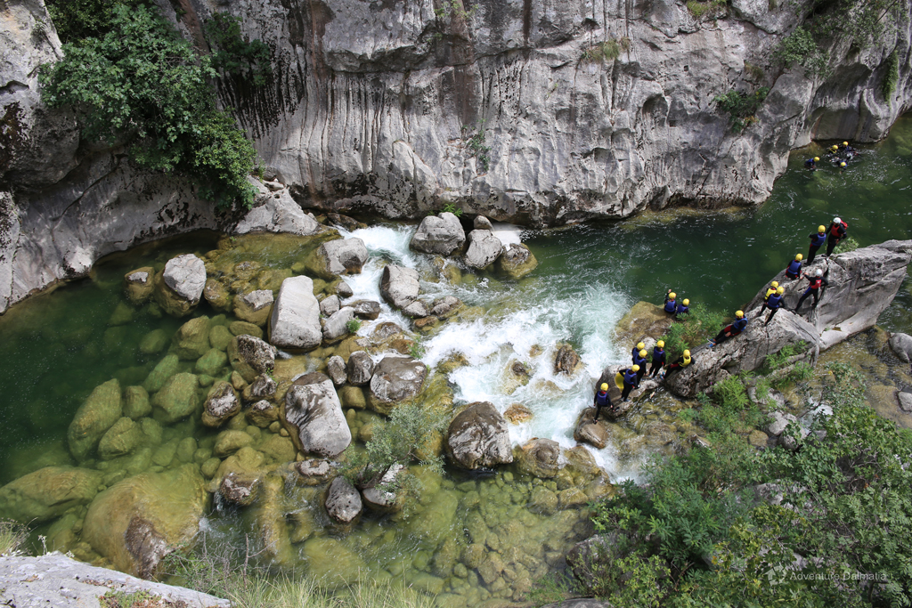 Exciting jumping from the cliff on the Extreme Canyoning tour