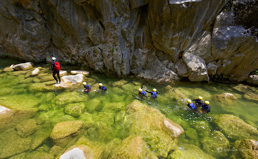 In and out of the river on Cetina Extreme Canyoning tour