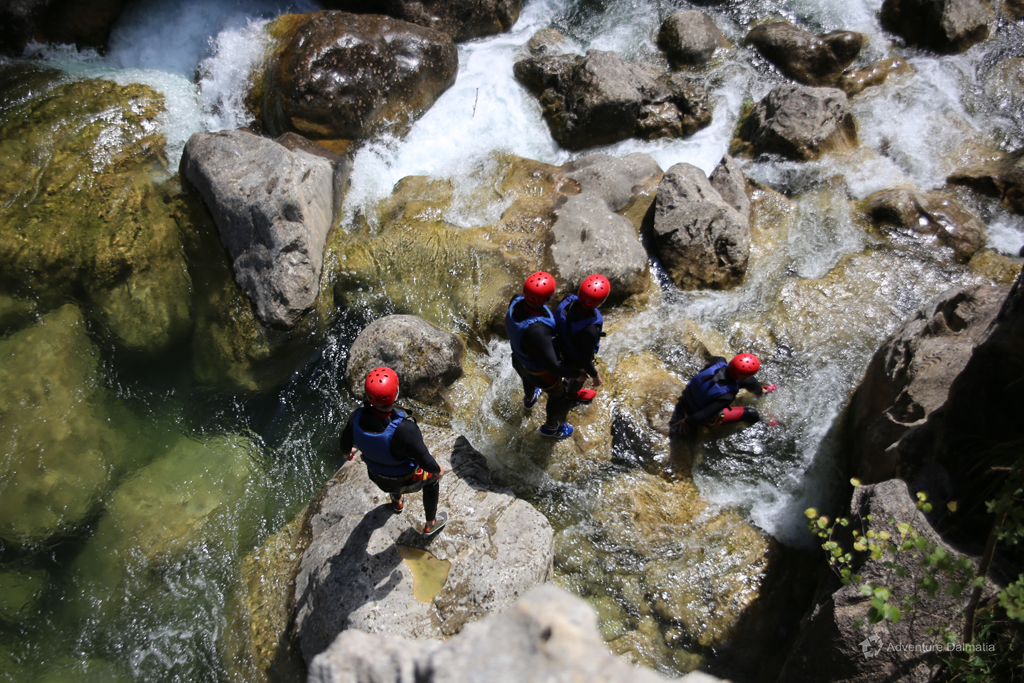 Jumping from rock to rock in the canyon, Cetina river