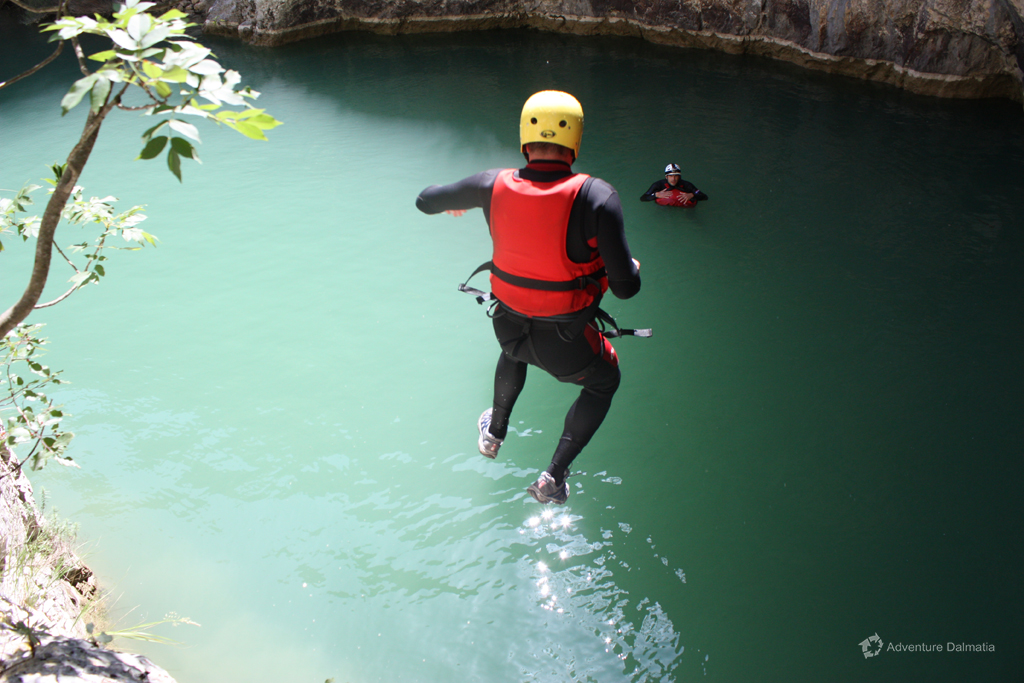 Jumping into the lake, Badnjevica canyoning tour