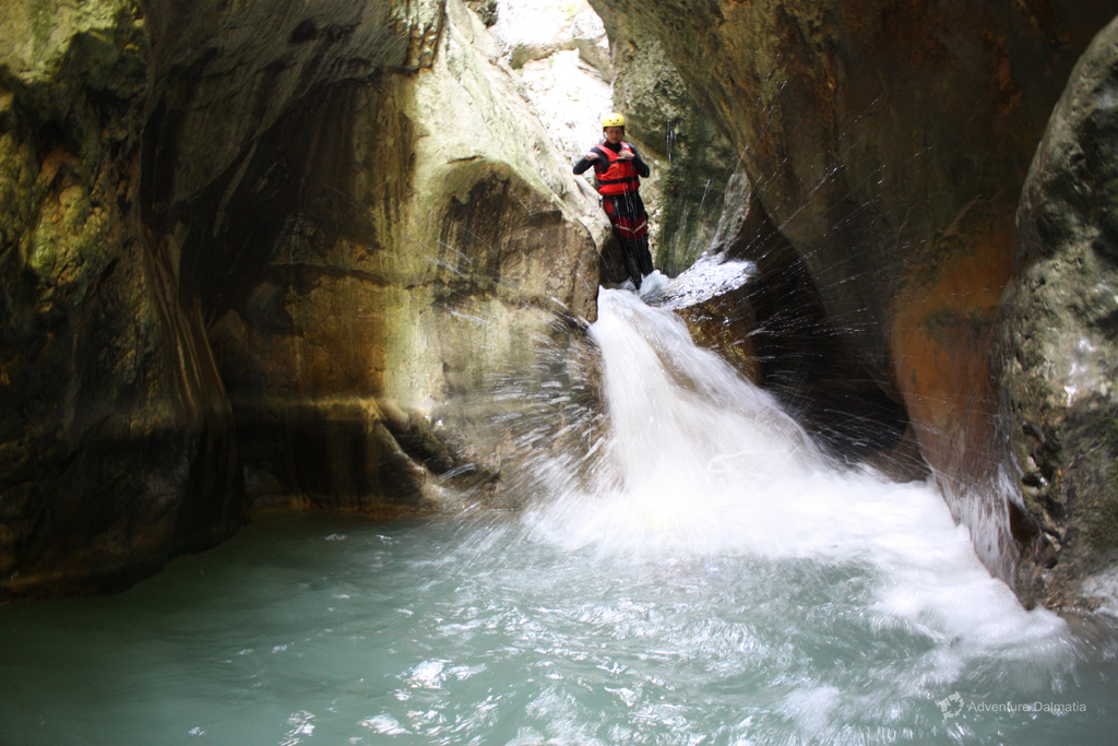 Jumping into the pool on Badnjevica canyoning tour