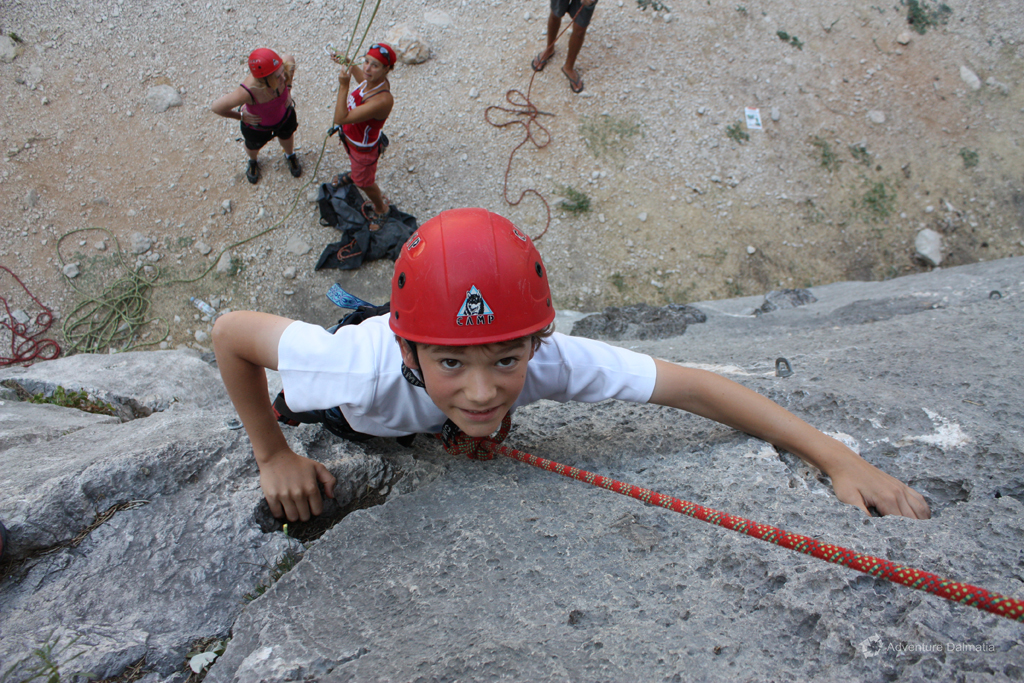 Safe in the hands of our guide on a rock climbing activity in Omiš