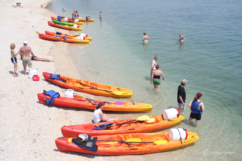 Swimming break on a kayaking tour in Trogir