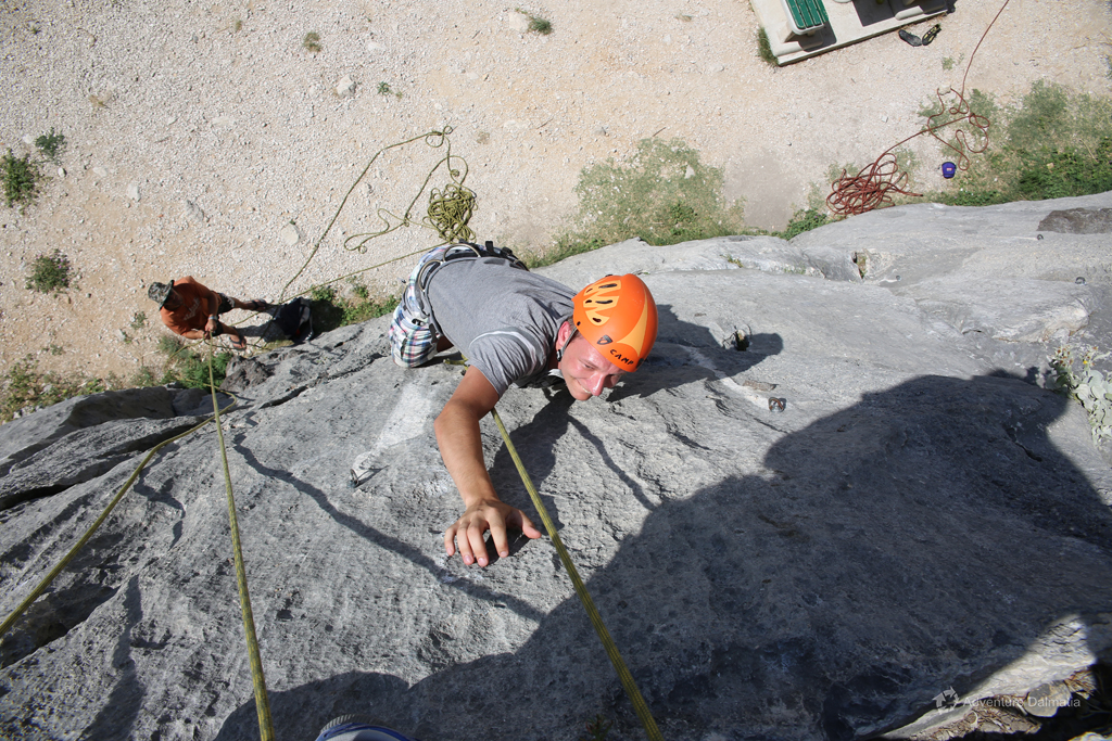 Trying to reach the top on one of the climbing routes in Omiš
