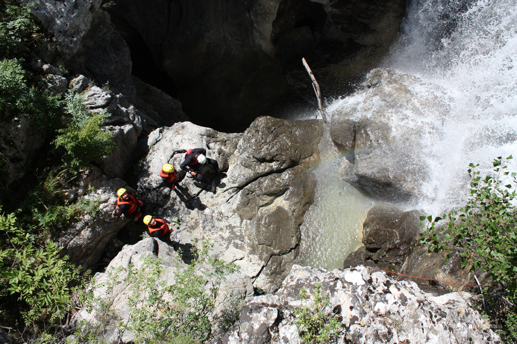 Under the waterfall on a Canyoning Badnjevica tour